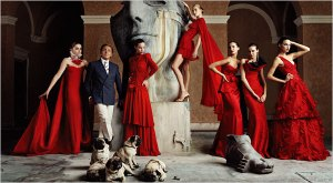 Valentino with his models, his designs and his infamous pugs at his Atelier in Rome